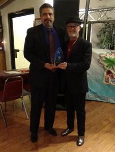 Enrique receives mental health hero award