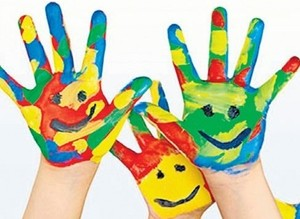 Painted hands of children crop